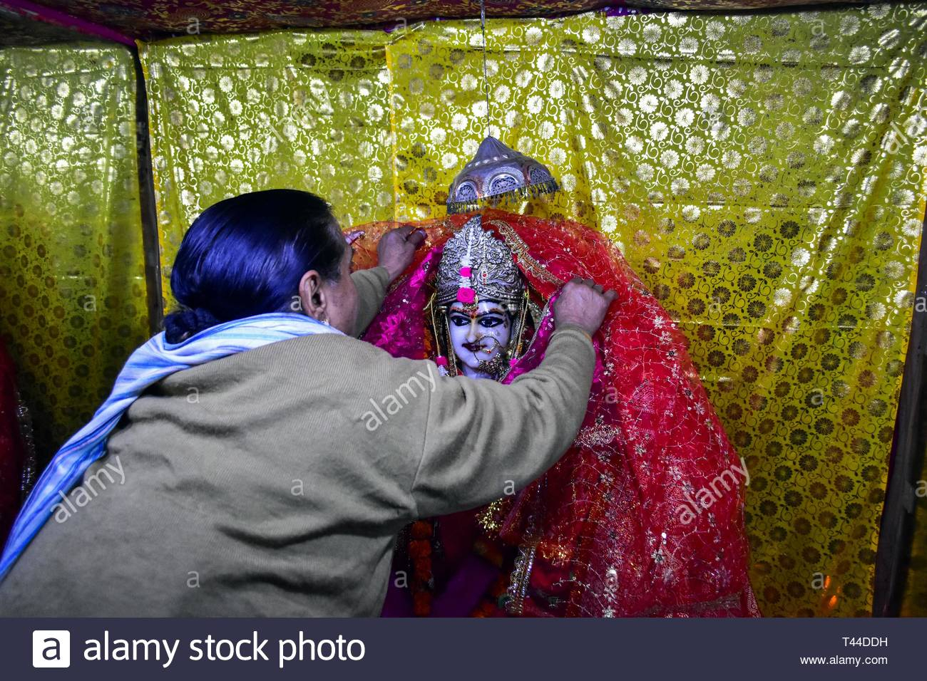 A Devotee Seen Performing Rituals During The Occasion. The within Om Lunar Calendar